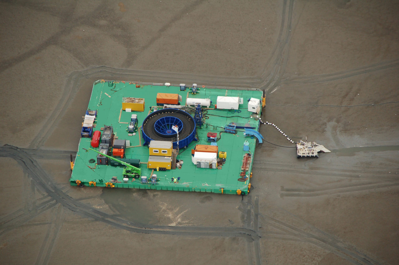 Combifloat customized cable lay barge beached